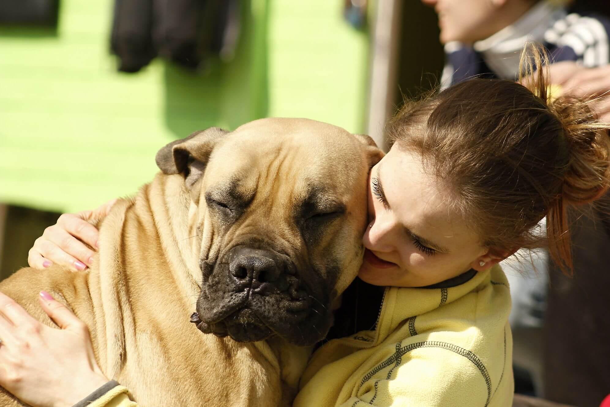 Woman Holding Dog
